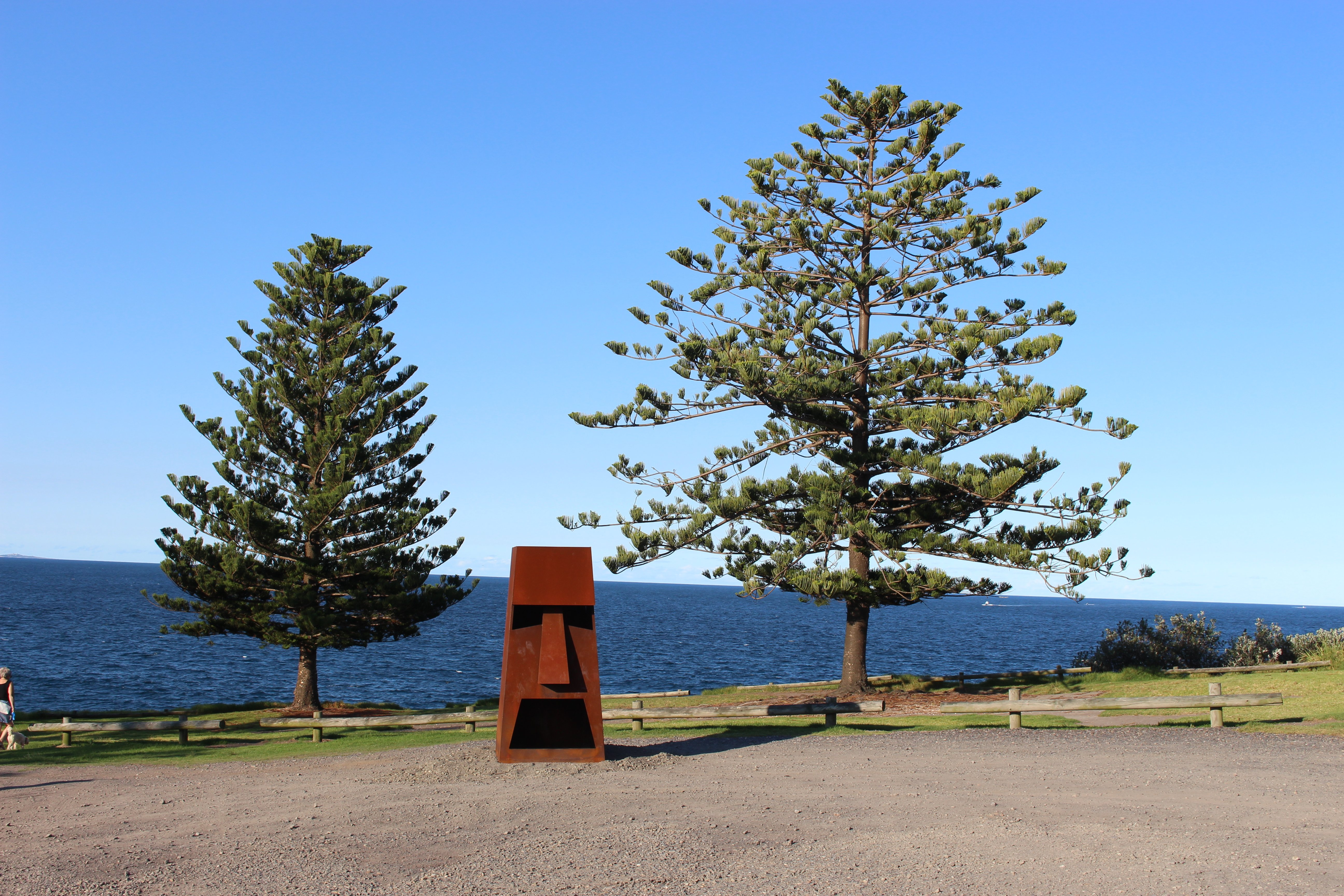 """Shannon Hobbs imposing fire sculpture """"Hot Head"""" sits at the end of the headland keeping watch. Photo: Ian Campbell."""