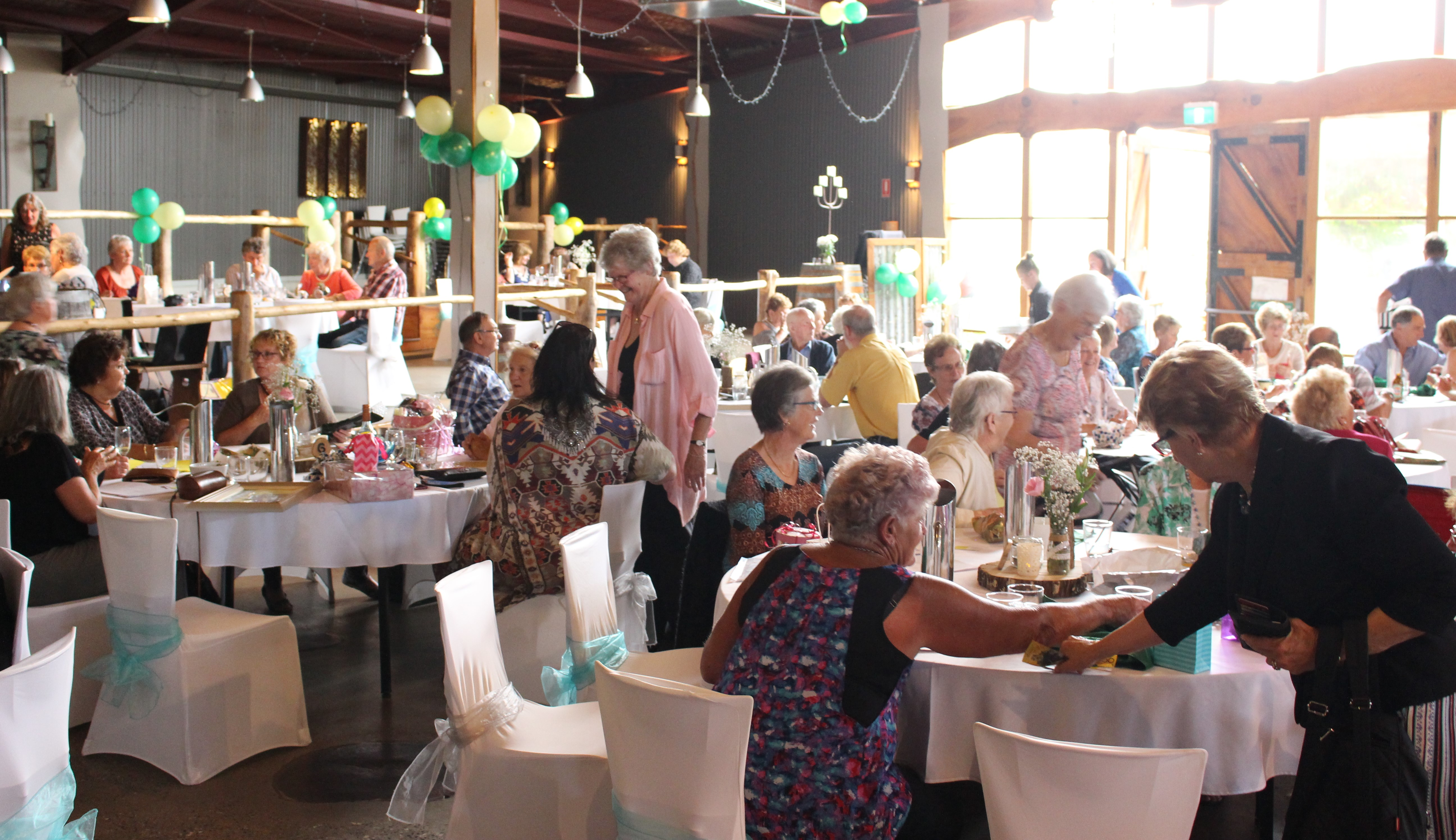 Around 150 people gathered for a lunchtime auction at Oaklands in Pambula, raising money for Can Assist. Photo: Ian Campbell.