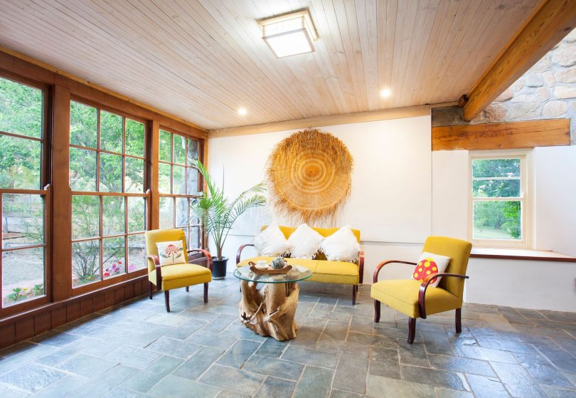 Slate flooring and soaring ceilings with Oregon beams. Photo: Supplied