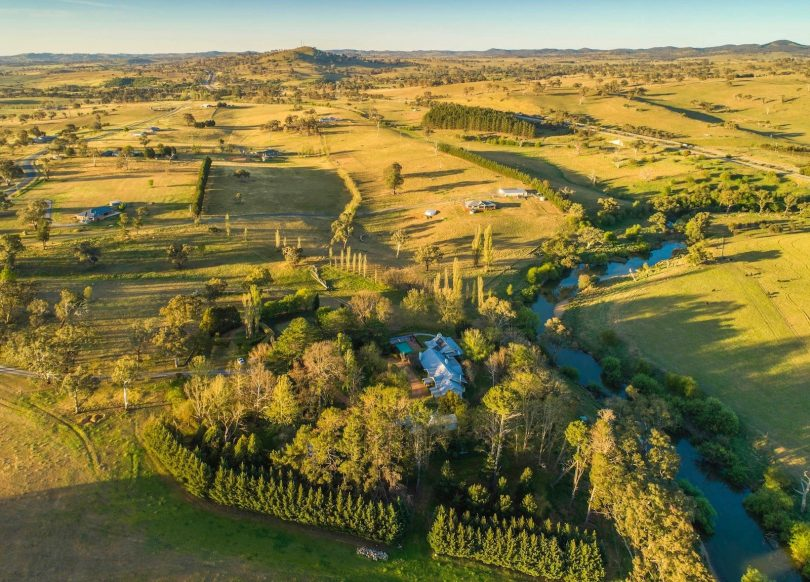 River frontage, rolling hills and a beautiful residence