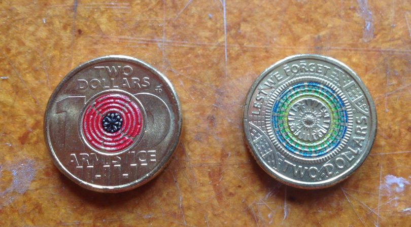 Tony Dean has his initials on two circulating two dollar coins in a series of Remembrance Day coins. Photo: Elka Wood.