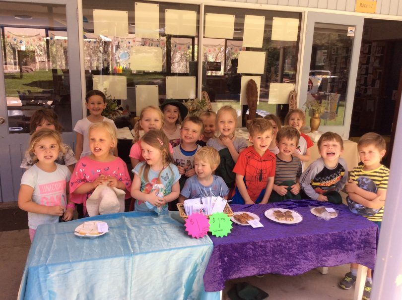 The kids of Pambula Preschool an their 2018 PNG cake stall. Photo: Supplied.