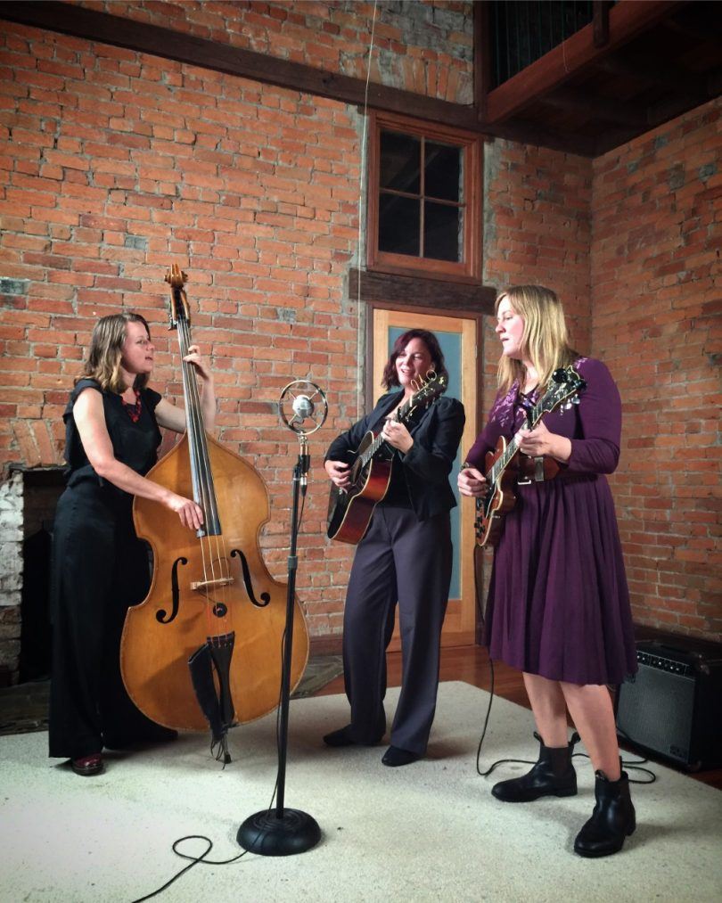 The New Graces band members Robyn Martin, Kate Burke and Melanie Horsnell performing in brick room.