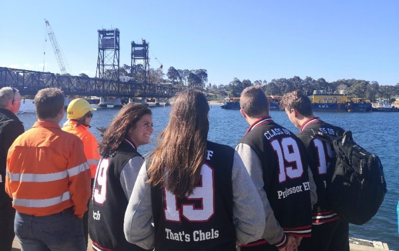 Batemans Bay High School students were among the crowd who welcomed a second massive construction barge to the Clyde River. Photo: Supplied.