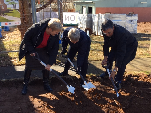 Professor Michelle Lincoln, Professor Imogen Mitchell and Professor Deep Saini turn the first sod on the joint ANU - UC facility in Cooma. Photo: Supplied.
