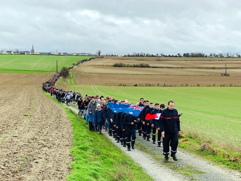 Villagers from Villers-Bretonneux, France, march through farmland to honour Australia's bushfire victims.
