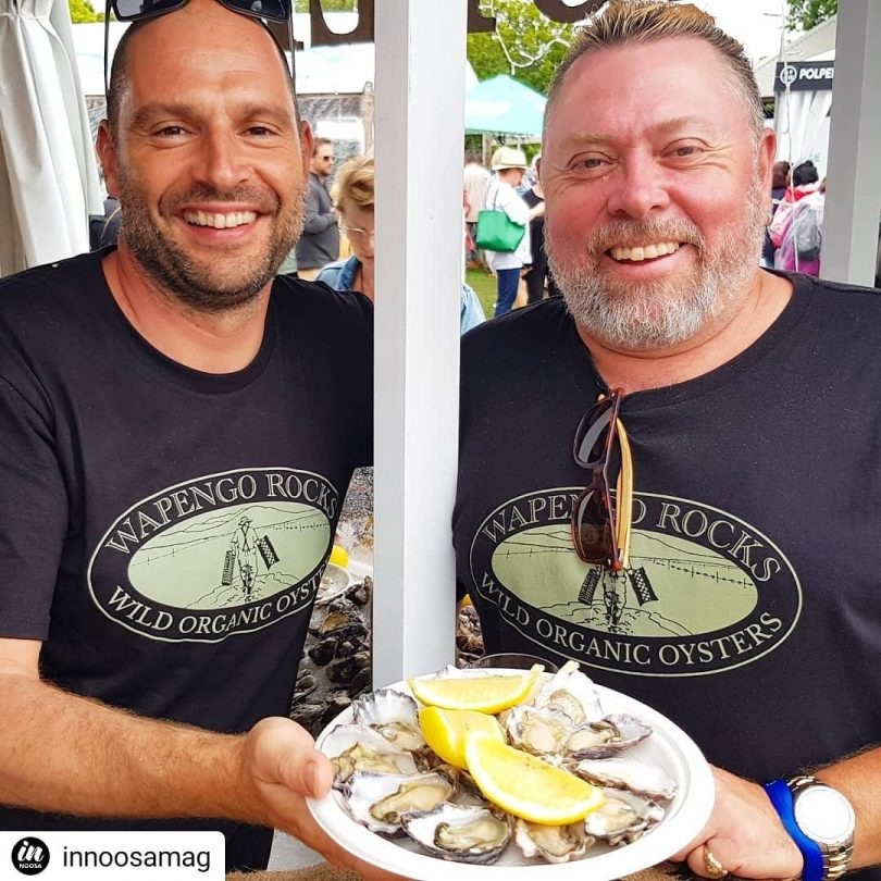 Oliver Shaw Carruthers (left) and oyster farmer Shane Buckley (right) holding plate of oysters.