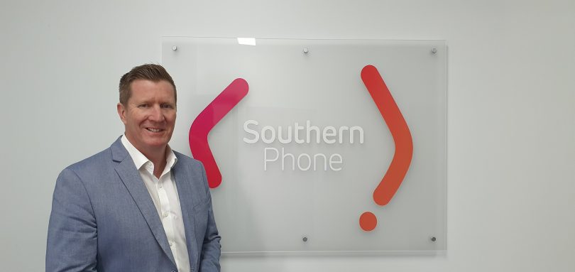 Southern Phone CEO David Joss standing in front of company sign.