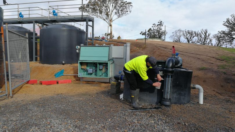 Council worker Paul Lazarro taking water at temporary water settling plant at Upper Brogo.