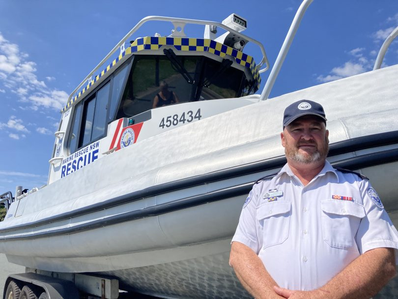 Glenn Sullivan standing next to marine rescue vessel 'Tuross 21'.