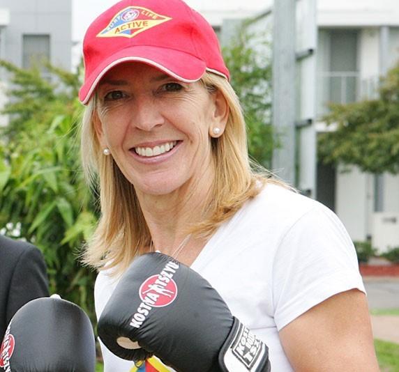 Former Olympian Jane Flemming wearing boxing gloves.