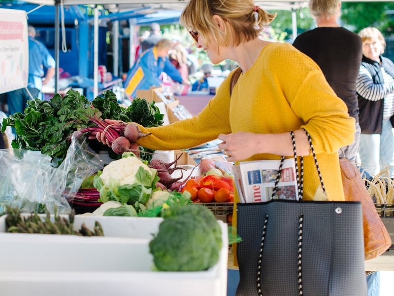 Woman shopping for produce at Yass Community Markets