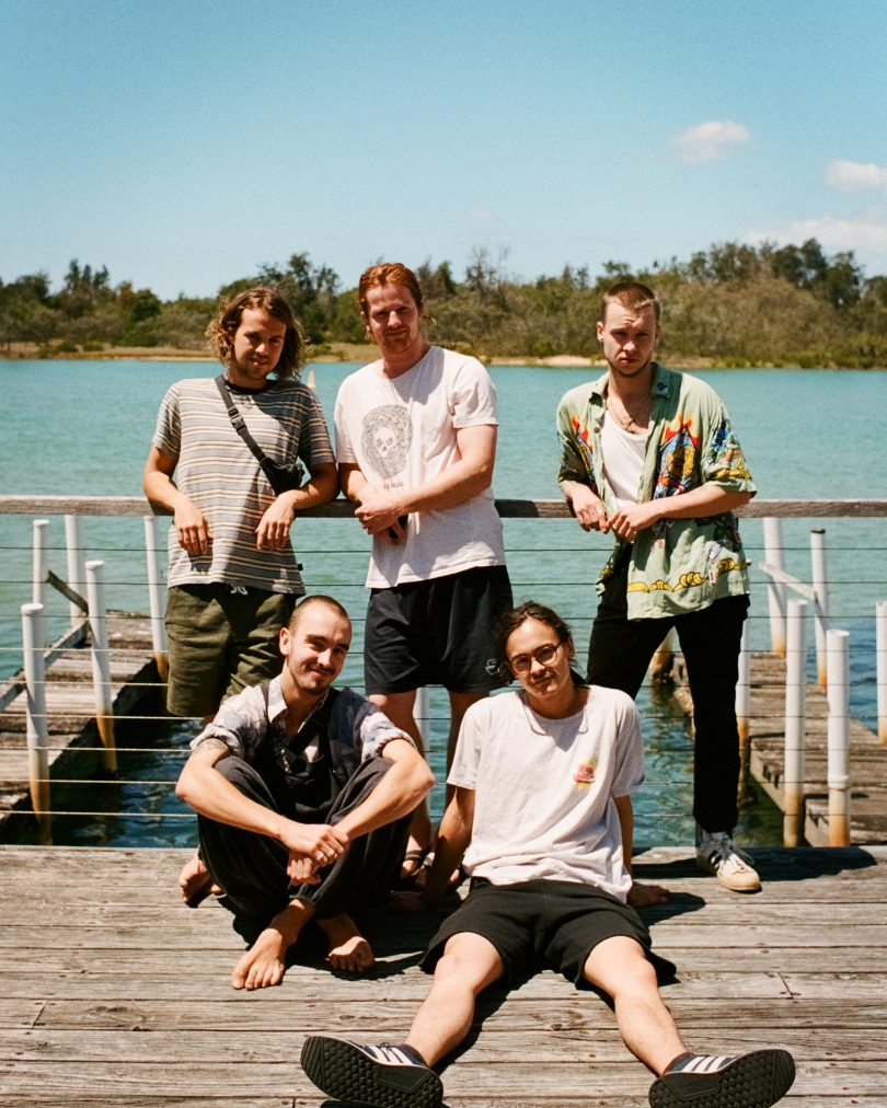 Band members from Thunder Fox standing on wharf