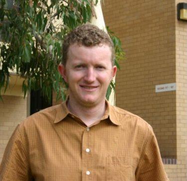 Associate Professor Gene Hodgins