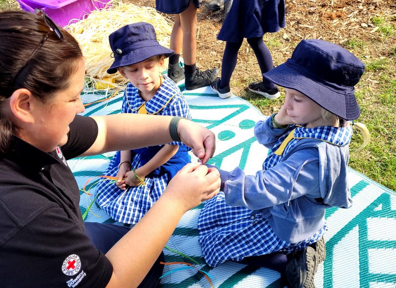 Member of Red Cross with Bermagui Public School students