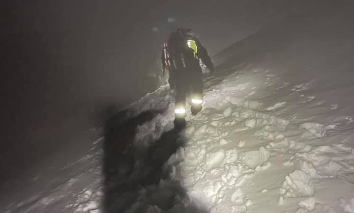 Fire and Rescue NSW rescuer hiking through snow at night in Kosciuszko National Park