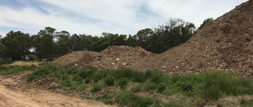 Mounds of soil at Environmental Earth Sciences International facility in Cootamundra